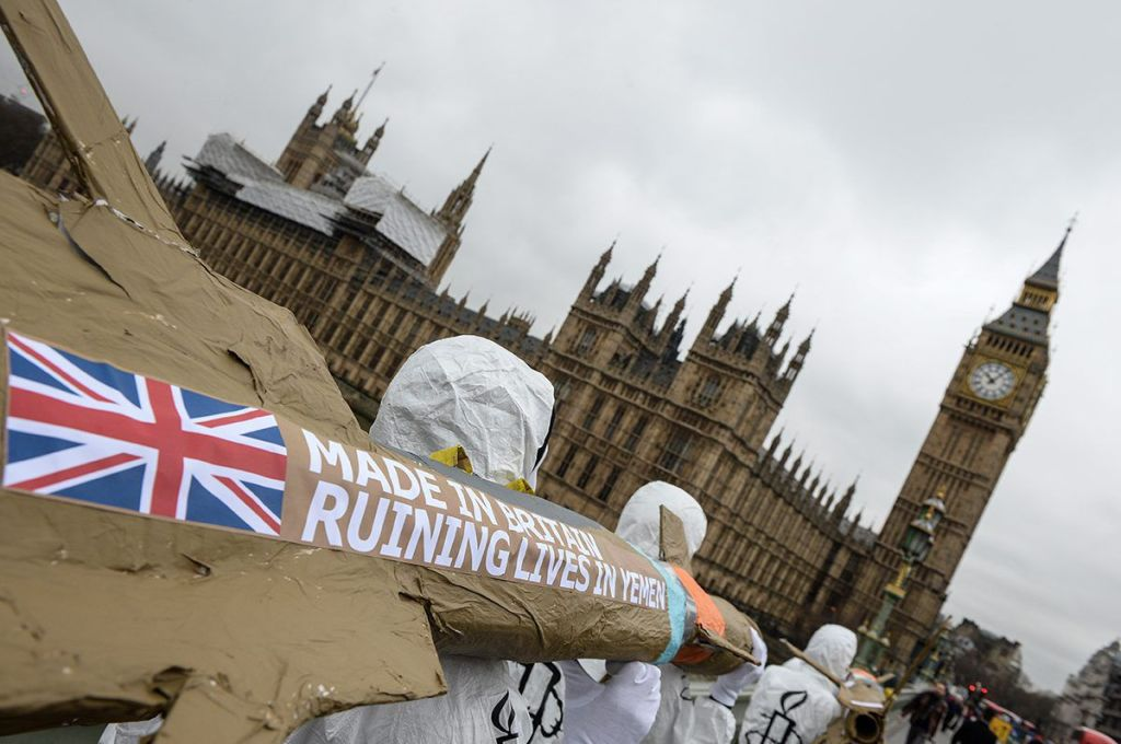 LONDON, ENGLAND - MARCH 18: Amnesty International activists march with homemade replica missiles bearing the message 'Made in Britain, destroying lives in Yemen' across Westminster Bridge towards Downing Street during a protest over UK arms sales to Saudi Arabia on March 18, 2016 in London, England. The missiles are replicas of the 500lb 'Paveway-IV' weapon which are currently used by Saudi Arabia's UK supplied Eurofighter Typhoon war planes. (Photo by Chris Ratcliffe/Getty Images)
